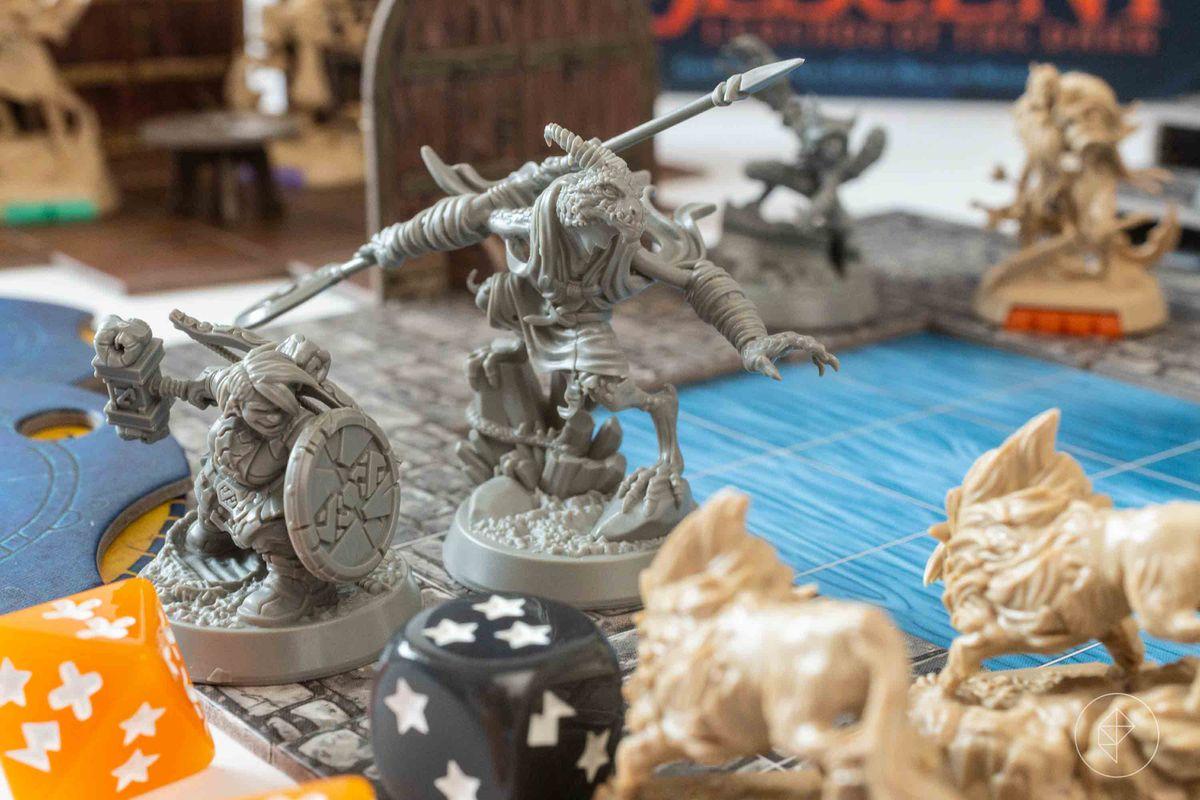 Un dragon et un nain affrontent une paire de loups.